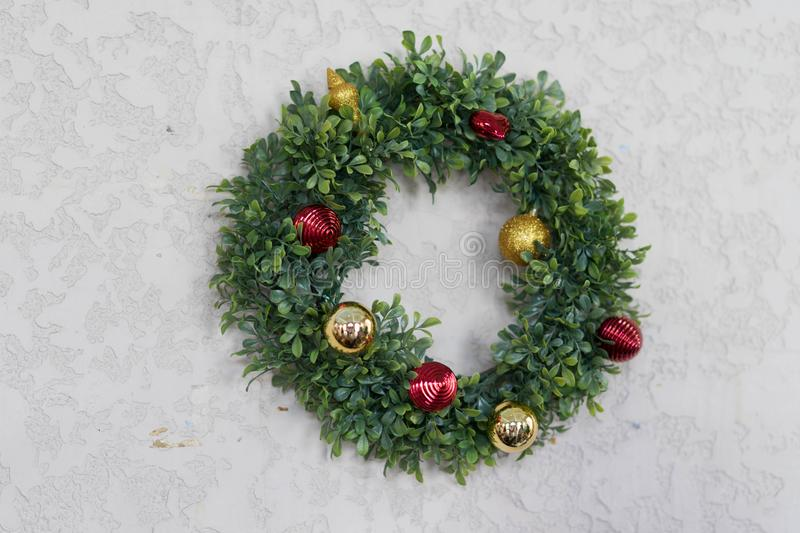 Christmas wreath decor on concrete wall. Wreath decor on concrete wall for party and sign of cerebration stock photo