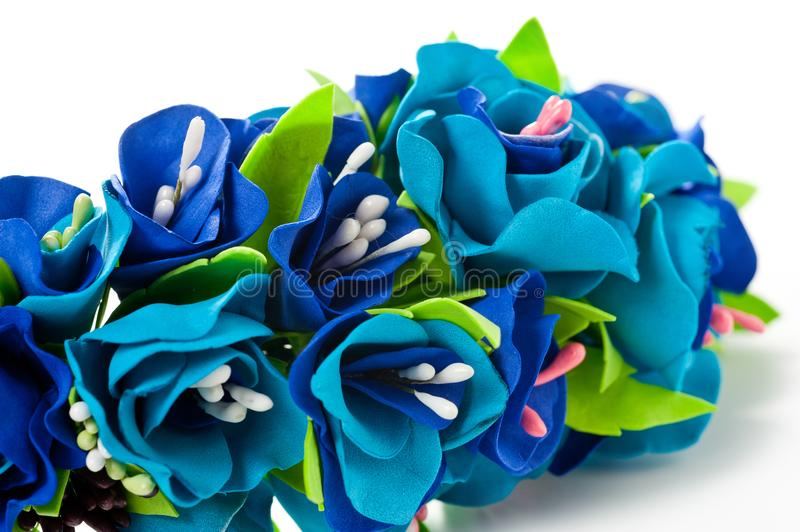 Wreath of flowers from fameirana handmade gently blue and purple on a white background stock image