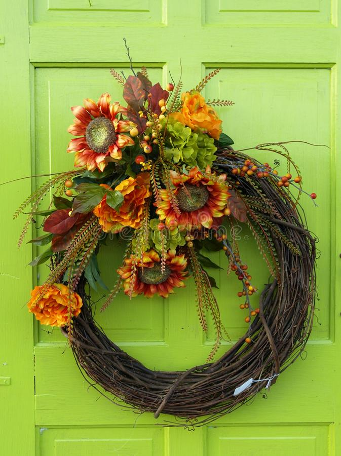 Flower wreath on a bright green door stock images