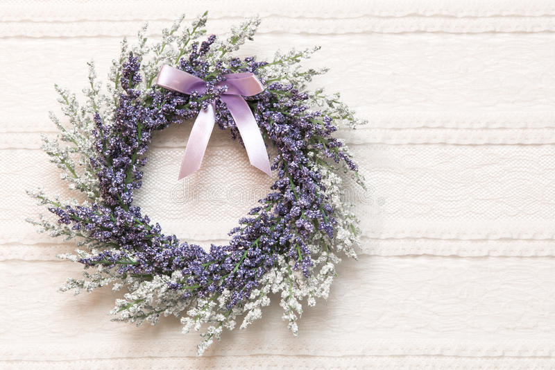 Wreath with lavender flowers on lace fabric background stock photography
