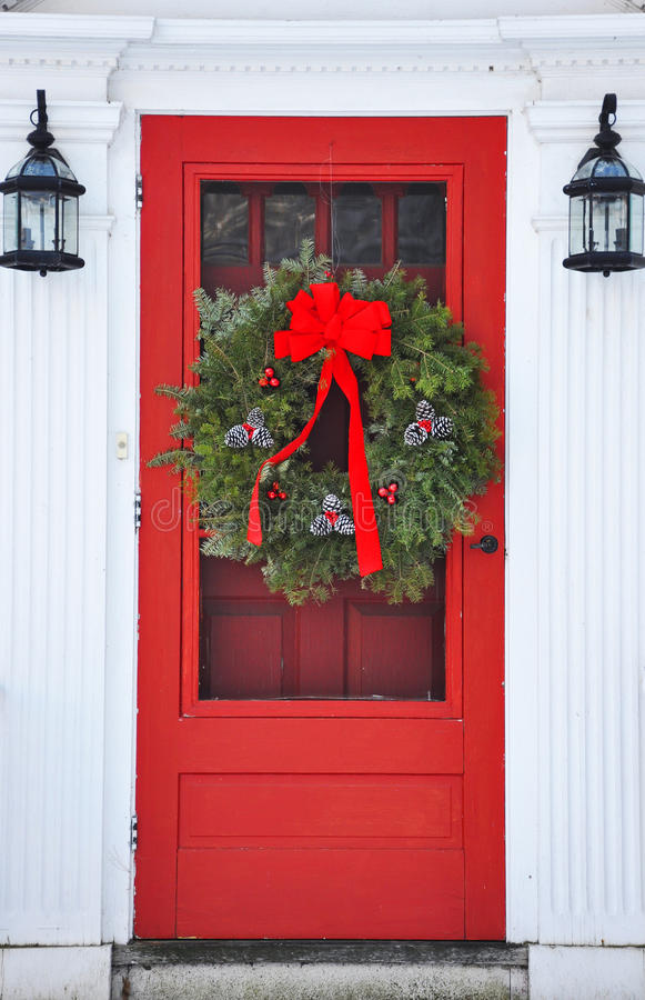 Wreath on red front door stock image image of holiday - What does a red front door mean ...