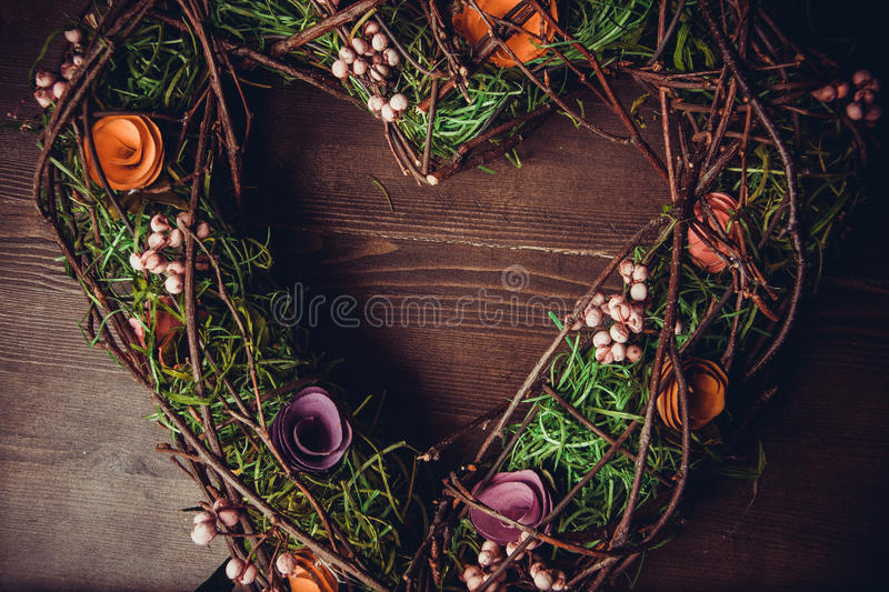 Wreath in a shape of heart made from grass royalty free stock images