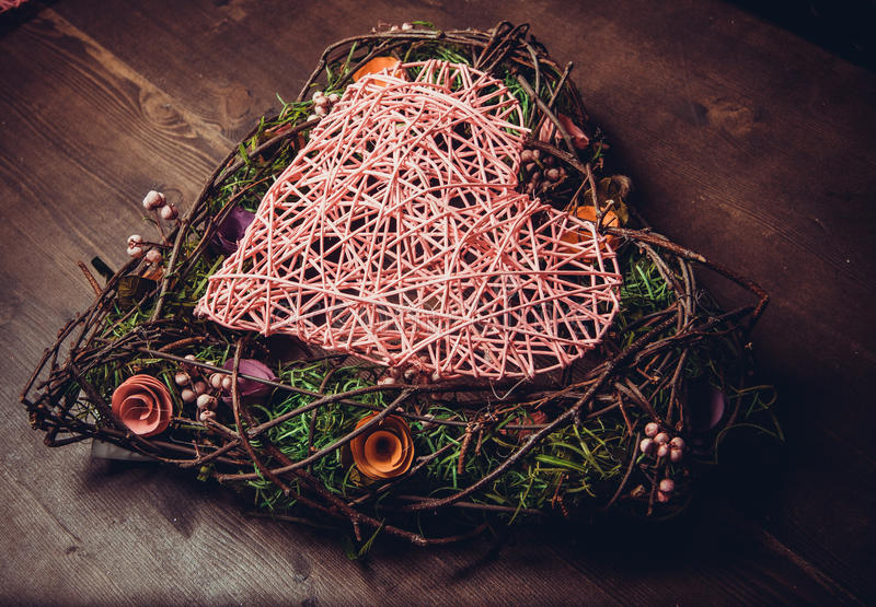 Wreath in a shape of heart made from grass stock image