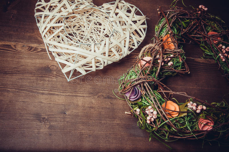 Wreath in a shape of heart made from grass stock photo