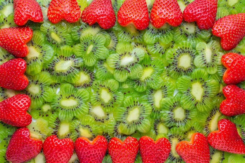 wreath of sliced kiwi and strawberry heart shape stock photography