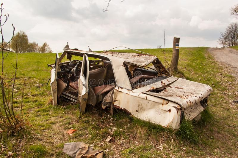 Wreck car on a dirt road. Disassembled vehicles. A cloudy spring day. stock photography