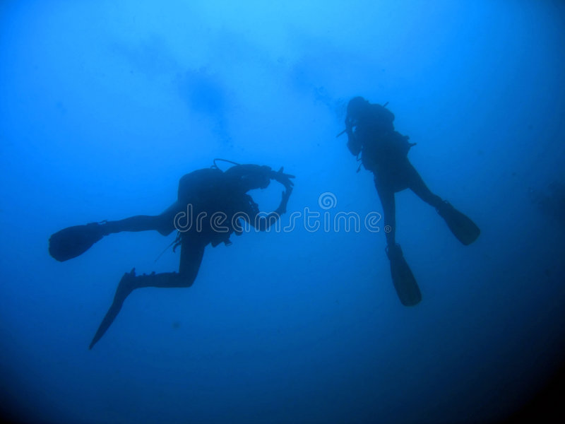Wreck dive scuba divers blue water philippines royalty free stock photography