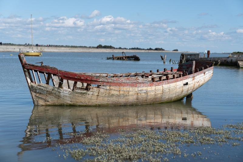Wreck of an old fishing boat in the boat graveyard royalty free stock photos