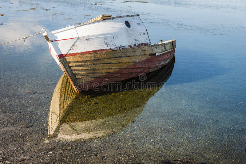 The wreck of an old fishing boat on the sea shore. Lofoten archipelago. royalty free stock image