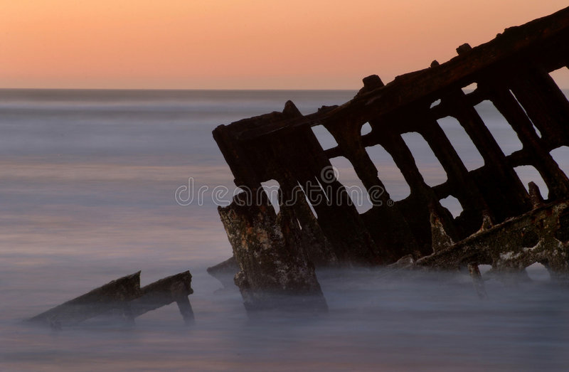 The Wreck of the Peter Iredale. Wreck of the Peter Iredale, 19th century ship, Fort Stevens State Park in Oregon. 30 second exposure royalty free stock photo