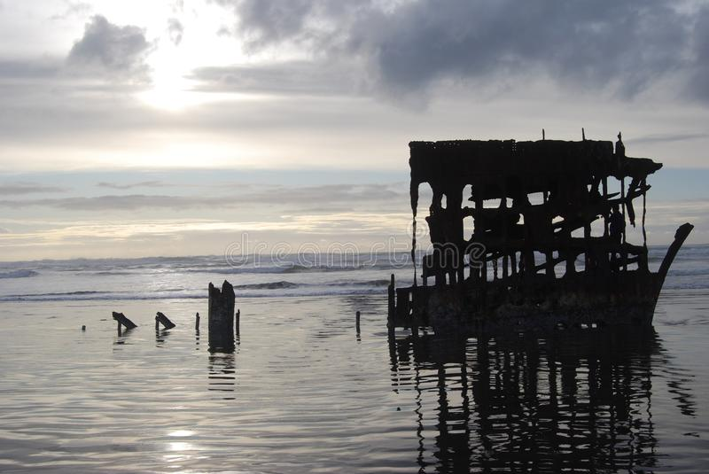 Wreck of the Peter Iredale. Current remains of the ship wreck Peter Iredale a four-masted steel barque sailing vessel that ran ashore October 25, 1906, on the stock images