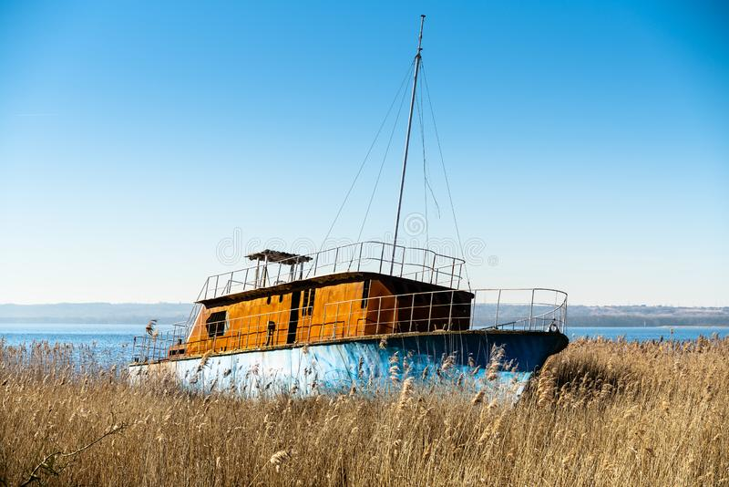 The wreck of a small ship, abandoned on the shore of the Szczecin Lagoon. Vintage effect stock images