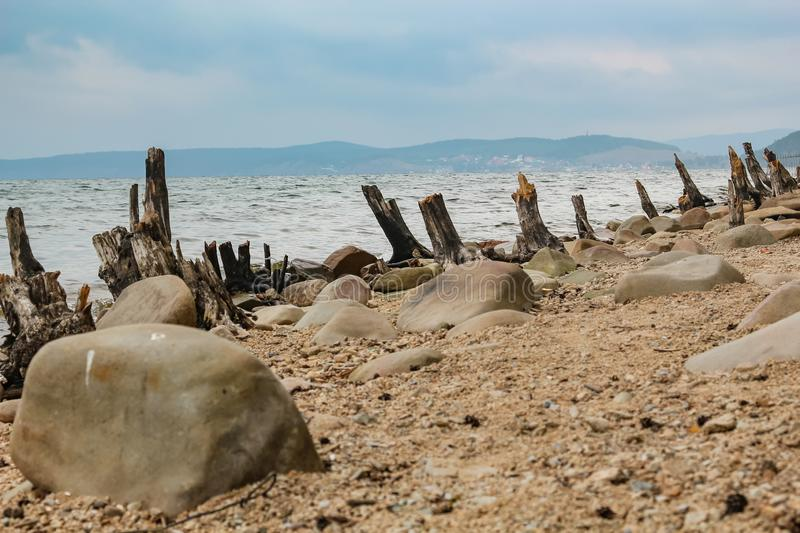 Wreckage of trees thrown on the shore of Lake Turgoyak in the Chelyabinsk royalty free stock photography