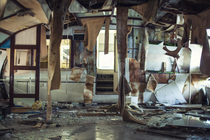Wrecked abandoned ship interior after shipwreck. Wrecked abandoned passenger ship interior after shipwreck royalty free stock photos