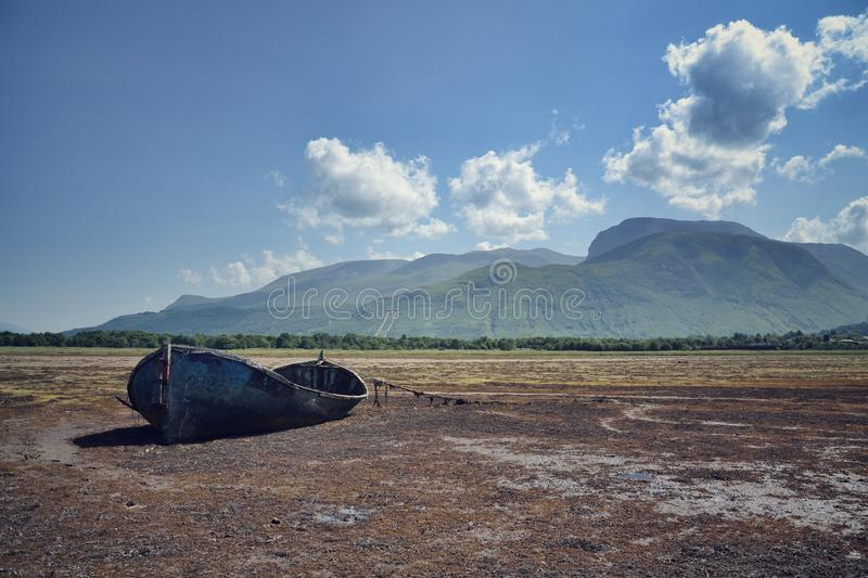 Wrecked boat. With Ben Nevis in background, Fort William, Scotland, United Kingdom royalty free stock photo
