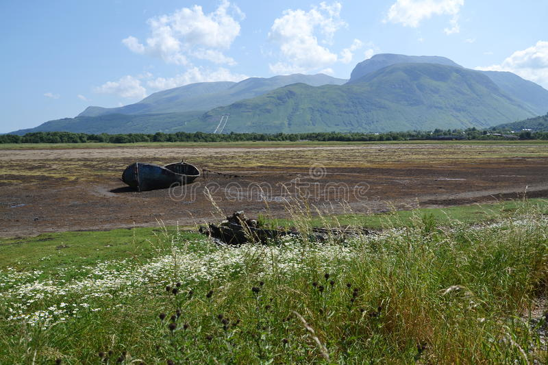 Wrecked boat. With Ben Nevis in background, Fort William, Scotland, United Kingdom stock photography