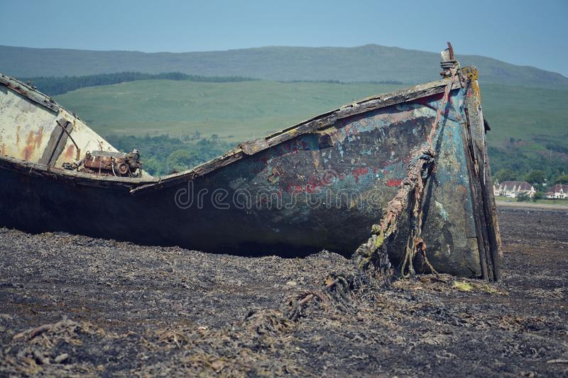 Wrecked boat. In Fort William, Scotland, United Kingdom royalty free stock image