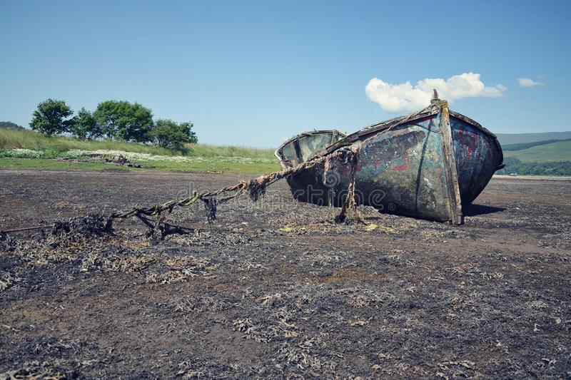Wrecked boat. In Fort William, Scotland, United Kingdom royalty free stock photography