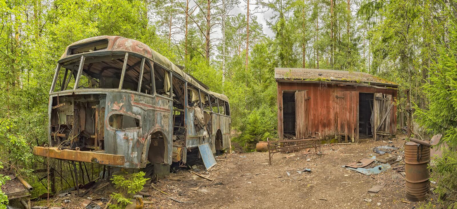 Wrecked Bus in Car Graveyard royalty free stock images
