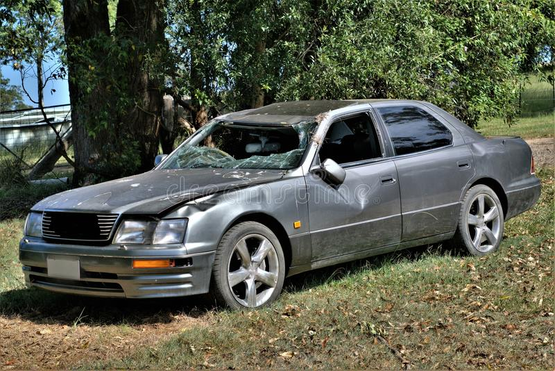 Wrecked car junk yard. Automobile at junk yard. Old car metal in junk yard. Accidental car at junkyard. Road accident. Vehicle accident. Broken car stock photo