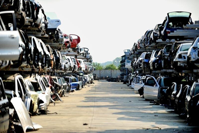 Wrecked car junkyard. Wrecked vehicles are seen in a car junkyard royalty free stock photo