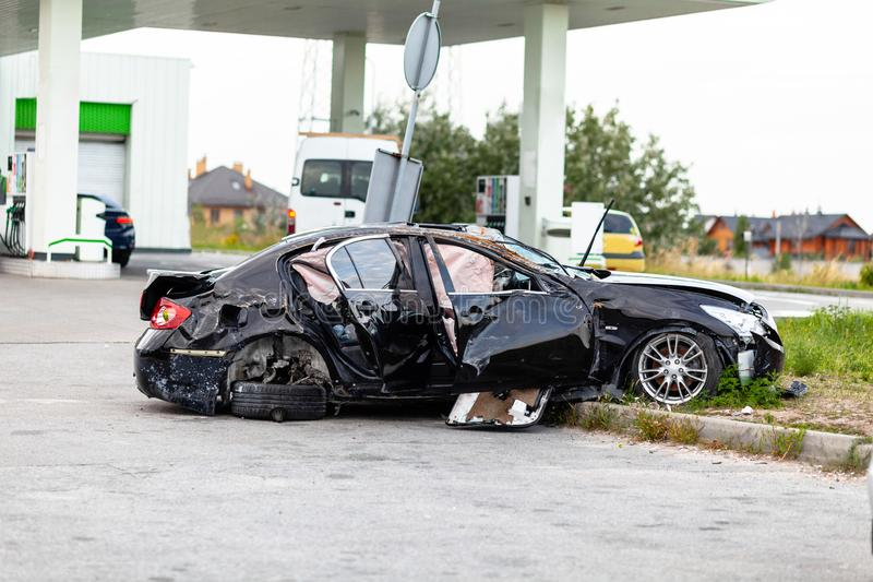 Wrecked car on side of highway. Safety on road. Accident or crash.  stock images
