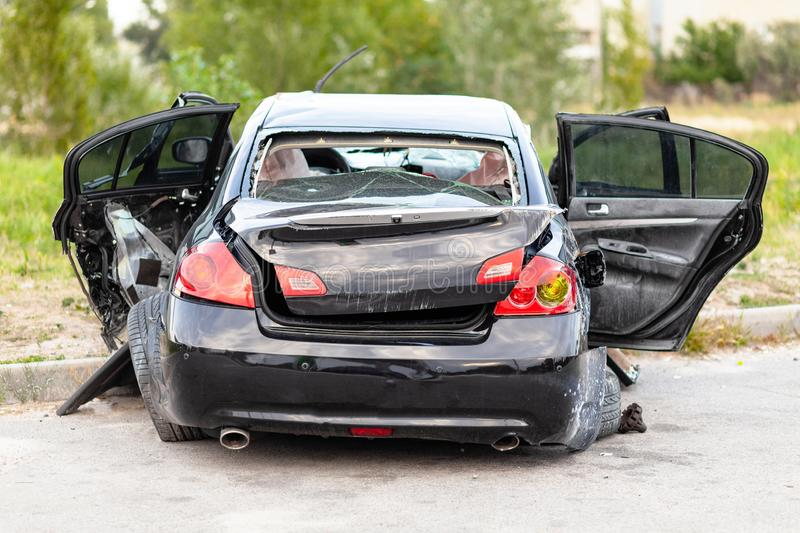 Wrecked car on side of highway. Safety on road. Accident or crash.  royalty free stock images