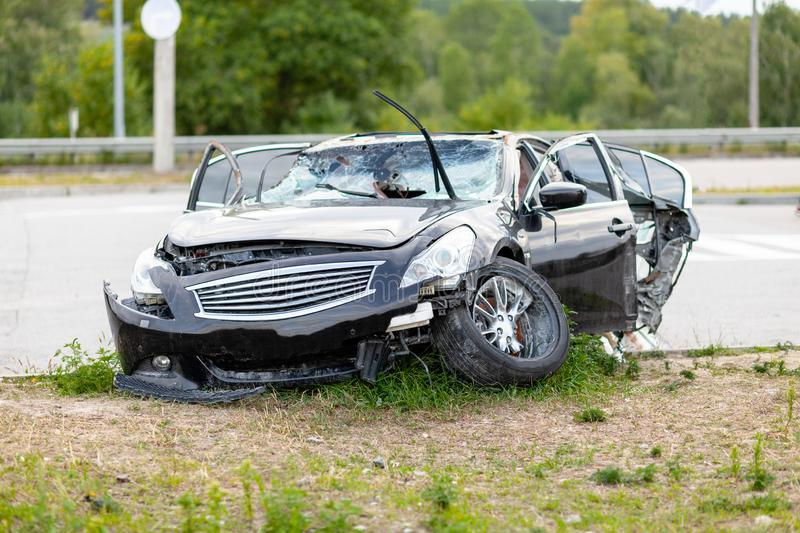 Wrecked car on side of highway. Safety on road. Accident or crash.  royalty free stock photo