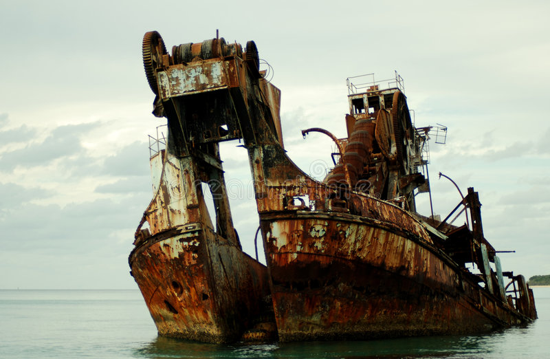 Wrecked dredge. Color shot of a ship wreck - formally a dredge royalty free stock images
