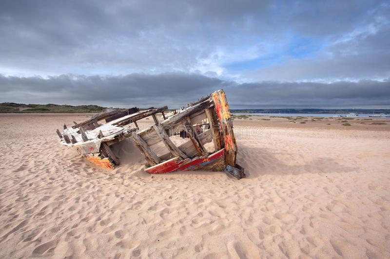 Wrecked fishing boat at crow point. A abandoned fishing boat at crow point near Braunton Devon Uk stock photo