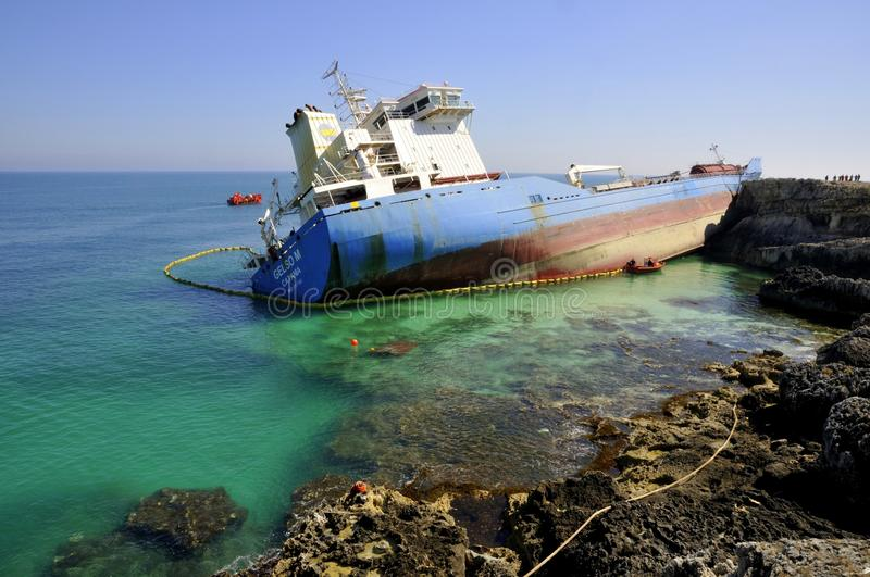 Wrecked oil tanker in clean sea water stock photos