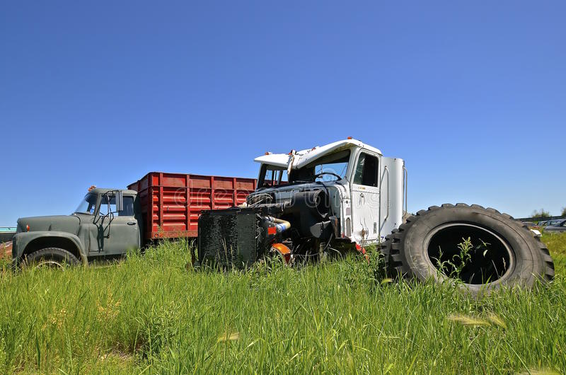 Wrecked truck in a salvage and junkyard stock image for Scrap tractor tires