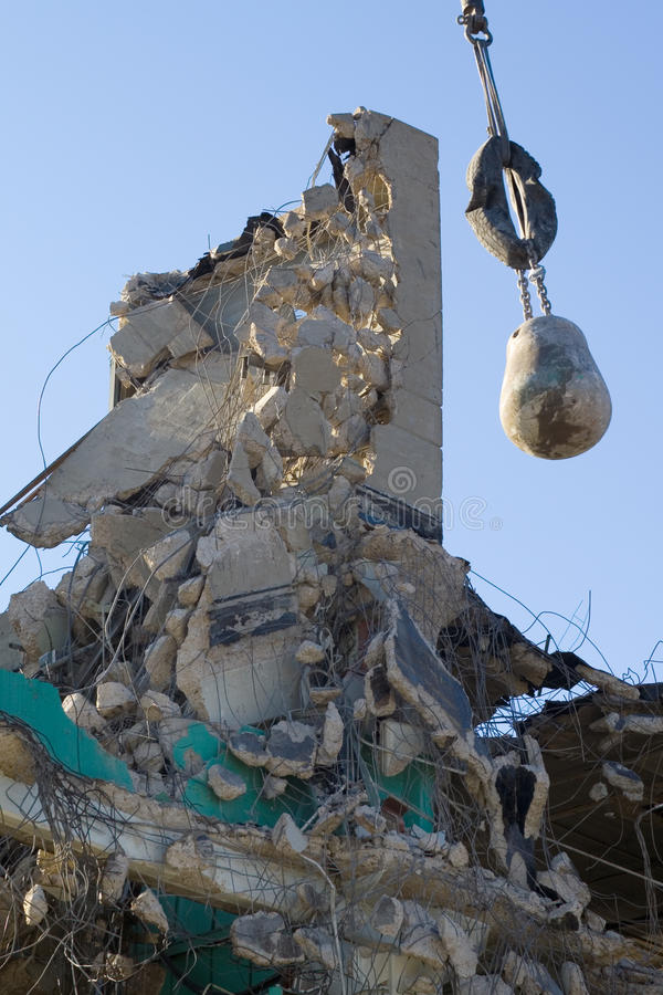 wrecking ball and demolished building royalty free stock