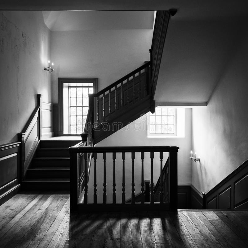 Wren staircase in the Wren Building. Wooden staircase in the historic Wren Building at the West End of Duke of Gloucester Street on the campus of the College of stock photo
