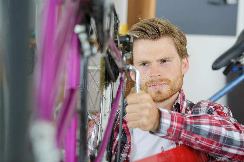Wrench and bike tire royalty free stock photography