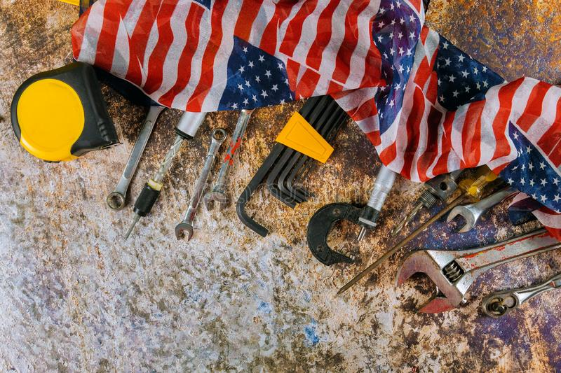 Wrench constructor tools on a United States of America flag in Labor Day is a federal holiday stock image