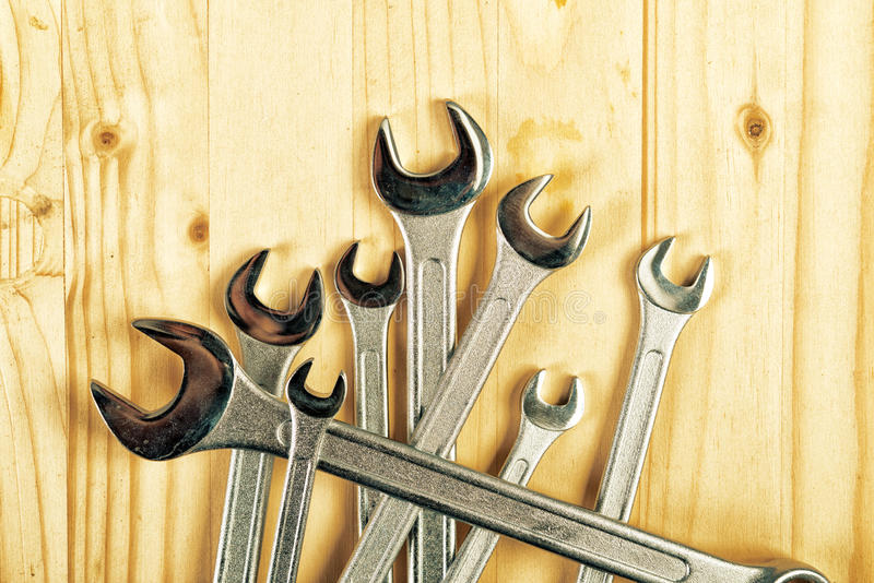 Wrench Jaw Spanner Tools. Piled on workshop table stock photos