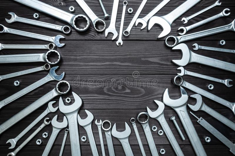 Wrenches and heart on dark wooden background. Concept love for their work. Wrenches and a heart on a dark wooden background. Concept love for their work stock images