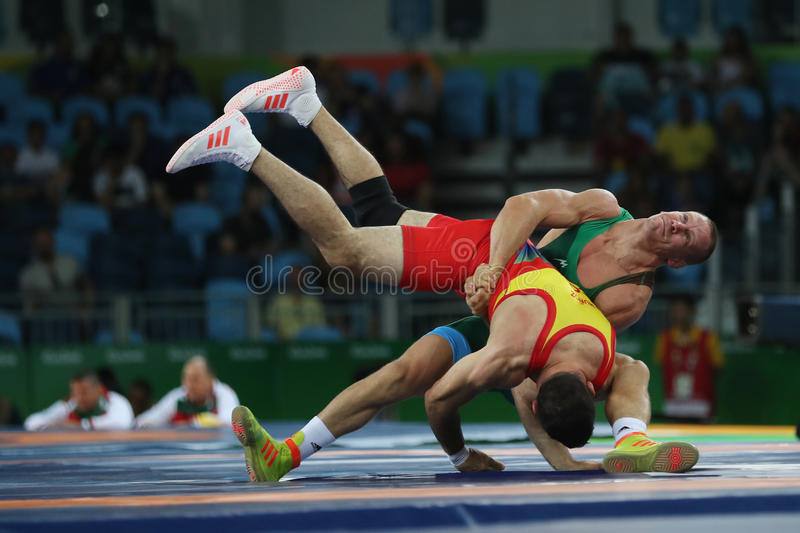 Wrestler Peter Basci of Hungary and Carlos Andres Munoz Jaramillo of Columbia during Men`s Greco-Roman 75 kg Qualification. RIO DE JANEIRO, BRAZIL - AUGUST 14 stock photography