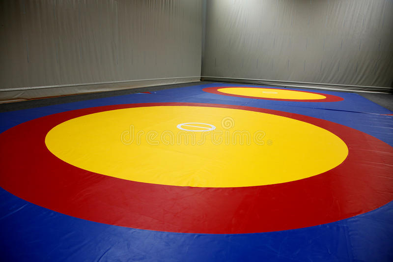 The wrestling mat. The hall with wrestling mat stock images