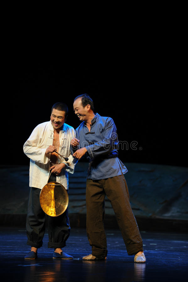 Wretched smile- Jiangxi opera a steelyard. Jiangxi opera a steelyard is adapted from a true story: the last century fortys, the protagonists father runs an oil stock photos