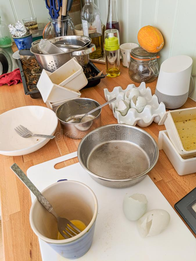 Authentic messy kitchen worktop, dirty dishes, Google Home. stock image