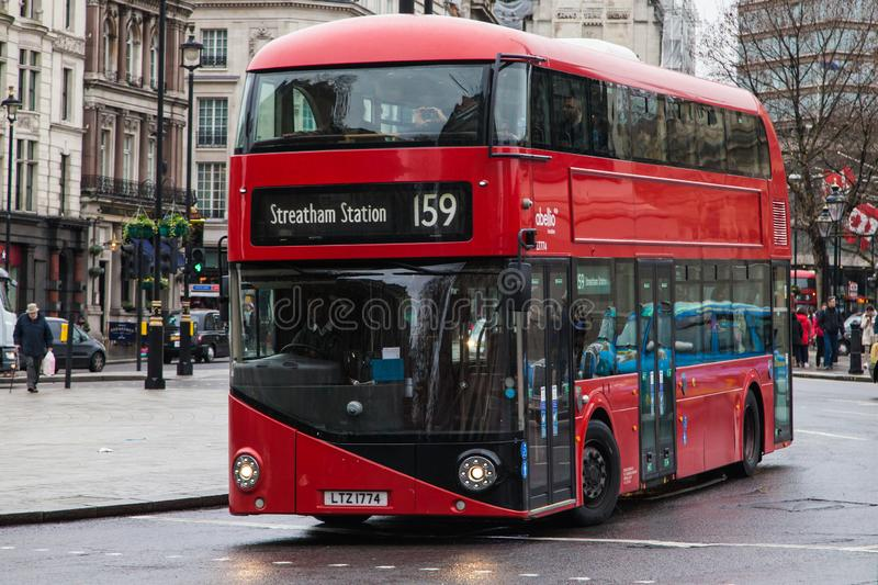 Wrightbus New Routemaster at Trafalgar Square. London, United Kingdom - December 23, 2019: Wrightbus New Routemaster travelling around Trafalgar Square heading royalty free stock images