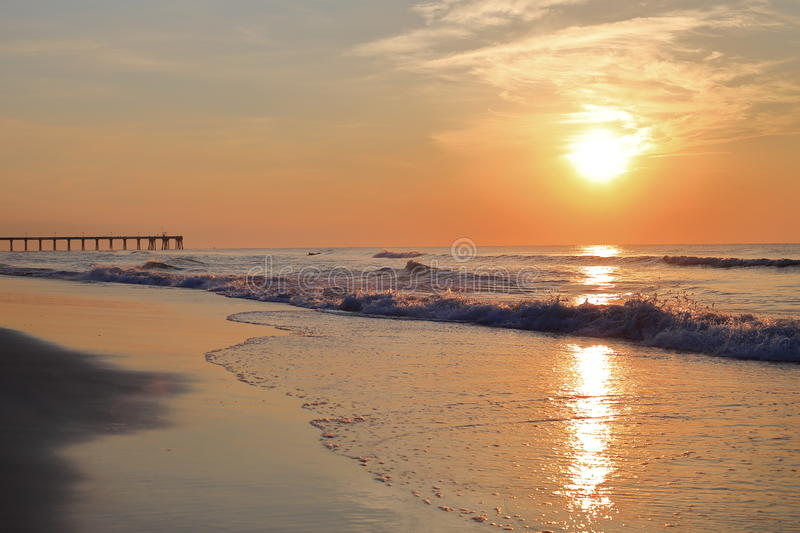 Wrightsville beach after sunrise. The sunrise time with colorful sky in Wrightsville beach, NC with pier stock image