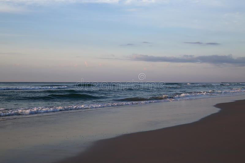 Wrightsville beach before sunset. The sunset time with colorful sky in Wrightsville beach, NC royalty free stock photography