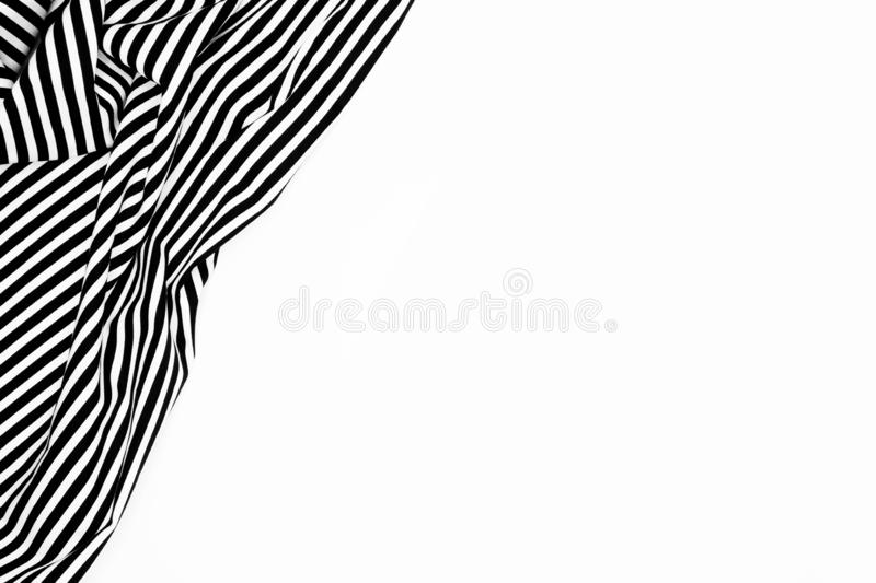 Wrinkled black and white striped fabric isolated on white background royalty free stock image