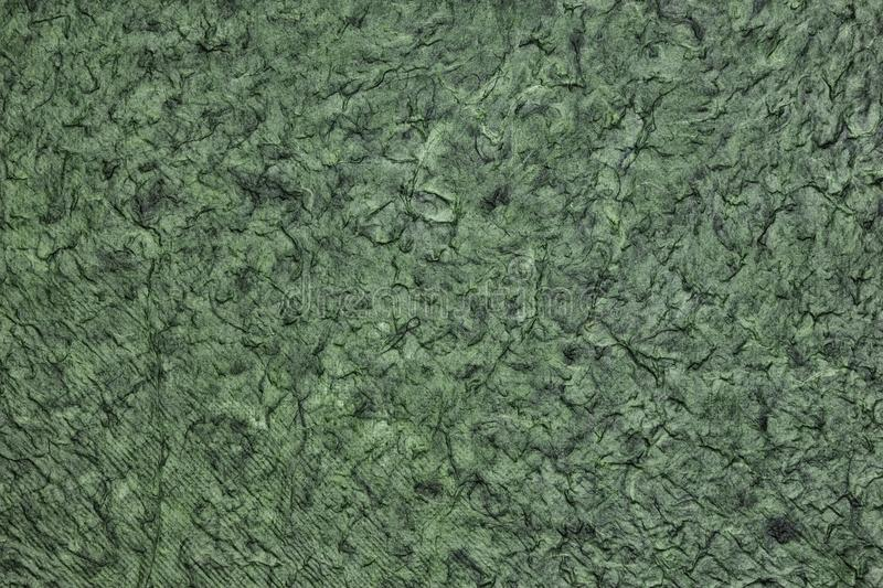 Wrinkled crumpled surface texture - dark green abstract background royalty free stock photos