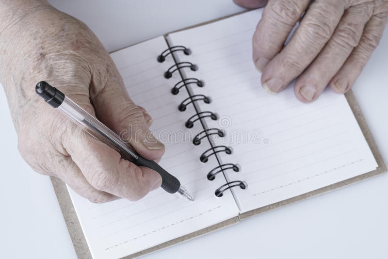 Wrinkled hand writing note with pencil stock photo