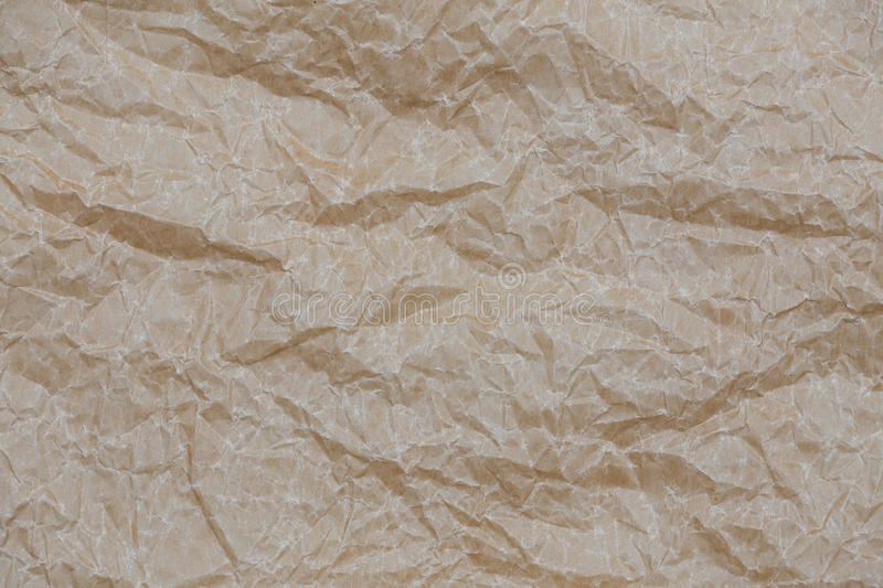 Wrinkled kraft paper. Top view brown crumpled paper background texture royalty free stock photography