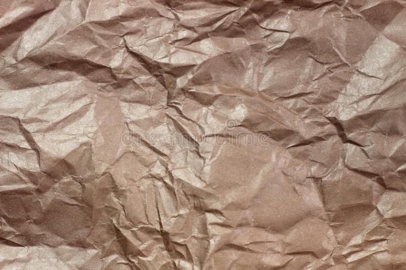 Wrinkled paper background. Texture of crumpled paper. Texture of crumpled old paper closeup. Background picture, transparency, clean, mulatto, cardboard, cunning stock photography